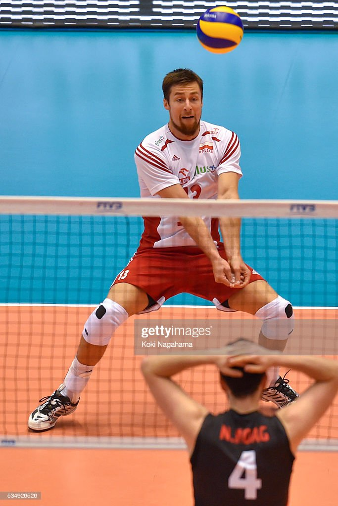 Michal Kubiak #13 of Poland receives the ball during the Men's World Olympic Qualification game between Poland and Canada at Tokyo Metropolitan Gymnasium on May 28, 2016 in Tokyo, Japan.