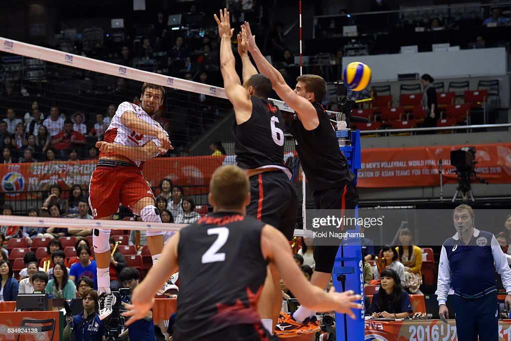 Michal Kubiak #13 of Poland spikes the ball during the Men's World Olympic Qualification game between Poland and Canada at Tokyo Metropolitan Gymnasium on May 28, 2016 in Tokyo, Japan.