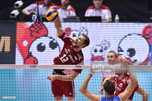 Michal Kubiak of Poland spikes the ball in the match between Italy and Poland during the FIVB Men's Volleyball World Cup Japan 2015 at Yoyogi...