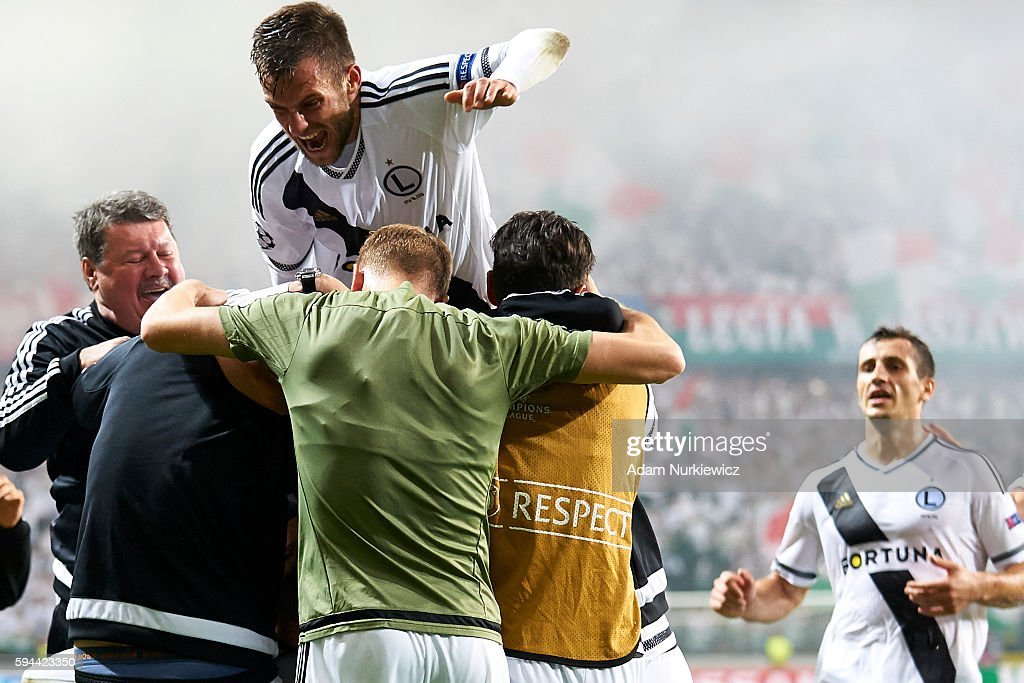 Michal Kucharczyk of Legia Warsaw celebrates with team mates after scoring during Legia Warsaw v Dundalk FC UEFA Champions League Play Off 2nd Leg at...