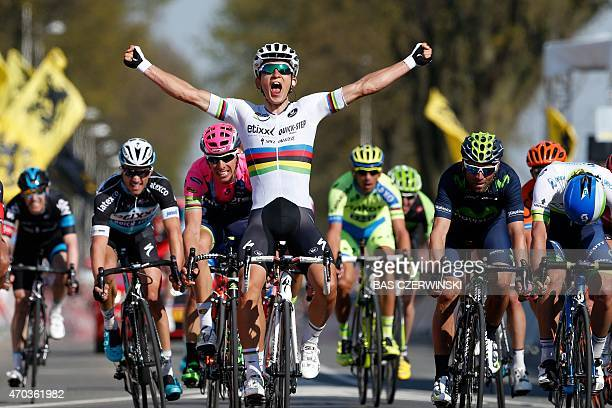 Michal Kwiatkowski celebrates as he crosses the finish line and win the 50th edition of the Amstel Gold race on April 19 2015 AFP PHOTO / ANP / BAS...