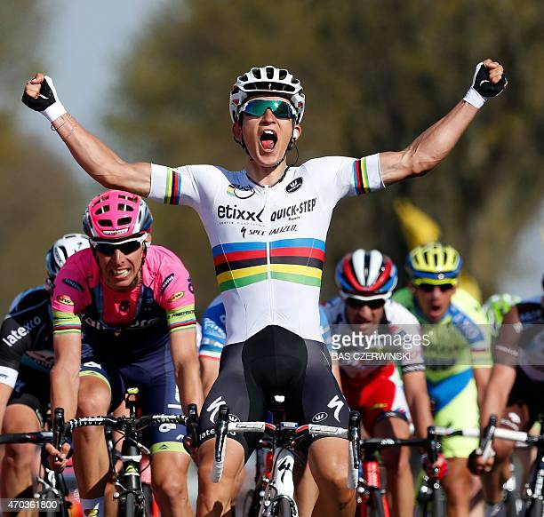 Michal Kwiatkowski celebrates as he crosses the finish line of the 50th edition of the Amstel Gold race on April 19 2015 AFP PHOTO /ANP /BAS...