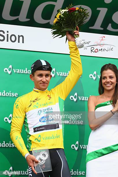 Michal Kwiatkowski of Poland and Omega PharmaQuick Step acknowledges the crowds applause after he retains the leaders yellow jersey during stage one...