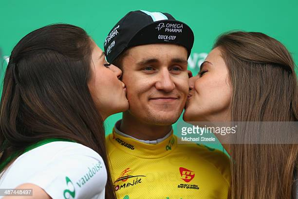 Michal Kwiatkowski of Poland and Omega PharmaQuick Stepreceives a kiss on each cheek after he retains the leaders yellow jersey during stage one of...