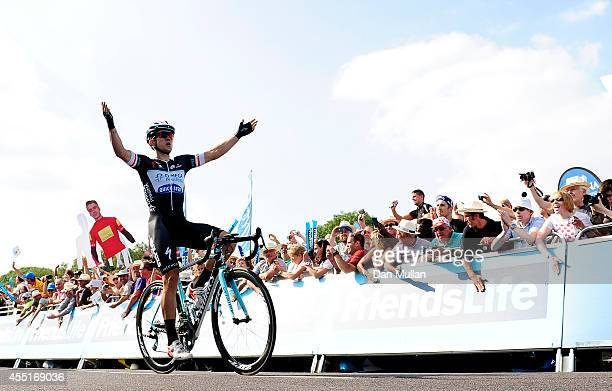 Michal Kwiatkowski of Poland and Omega PharmaQuikStep celebrates as he crosses the line to win during Stage Four of the 2014 Tour of Britain from...