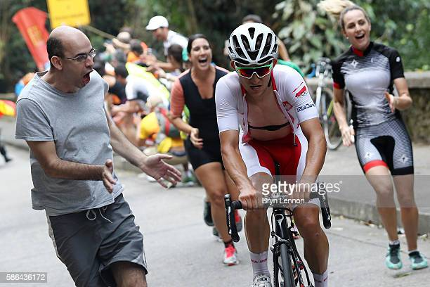 Michal Kwiatkowski of Poland is cheered by fans during the Men's Road Race on Day 1 of the Rio 2016 Olympic Games at the Fort Copacabana on August 6...