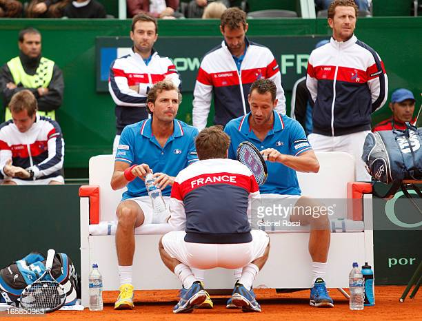 Michaël Llodra and Julien Benneteau talk to Arnaud Clement before a tenis match against David Nalbandian and Horacio Ceballos as part of the Davis...