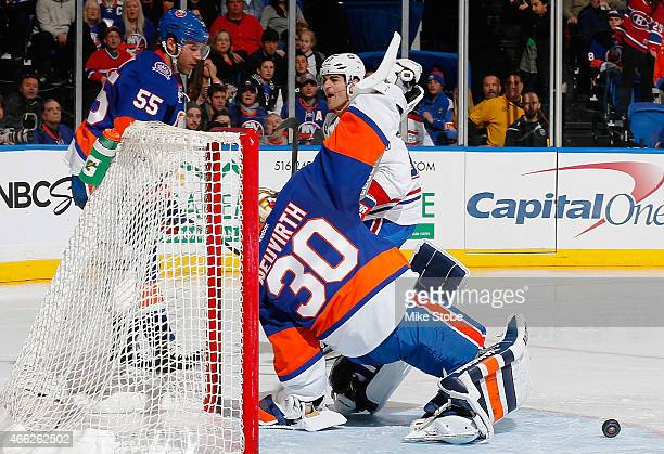 Michal Neuvirth of the New York Islanders allows a shorthanded goal by Max Pacioretty of the Montreal Canadiens in the second period at Nassau...