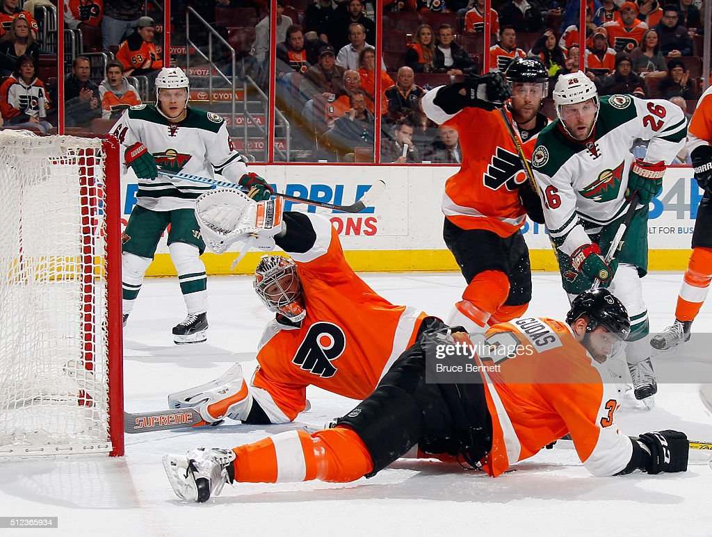 Michal Neuvirth of the Philadelphia Flyers blocks the net with 16 seconds remaining against the Minnesota Wild at the Wells Fargo Center on February...