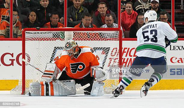 Michal Neuvirth of the Philadelphia Flyers deflects the puck over the crossbar from a shot on goal during the shootout by Bo Horvart of the Vancouver...