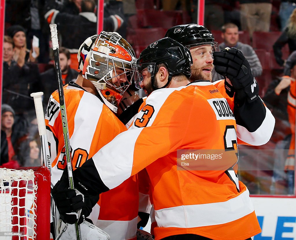 Michal Neuvirth #30 of the Philadelphia Flyers is congratulated by teammates Radko Gudas #3 and Nick Schultz #55 after the game against the Montreal Canadiens at the Wells Fargo Center on January 5, 2016 in Philadelphia, Pennsylvania.The Philadelphia Flyers defeated the Montreal Canadiens 4-3.