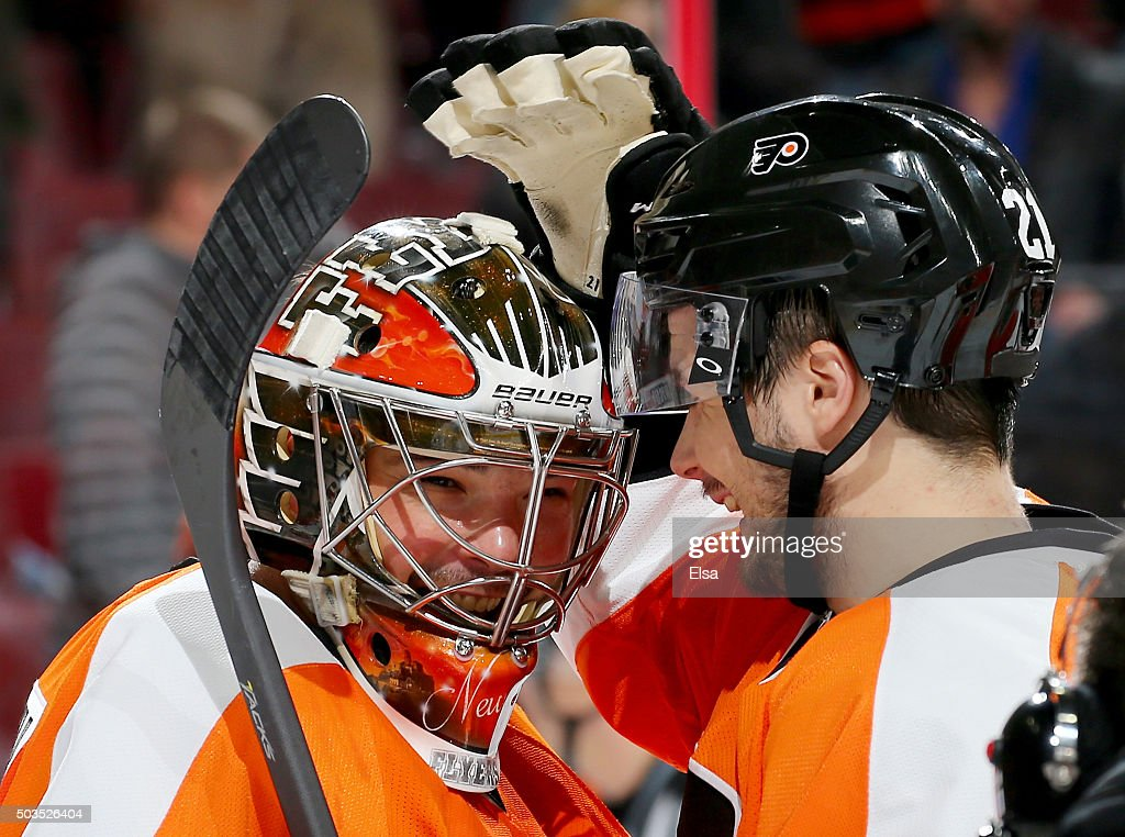 <a gi-track='captionPersonalityLinkClicked' href=/galleries/search?phrase=Michal+Neuvirth&family=editorial&specificpeople=3205600 ng-click='$event.stopPropagation()'>Michal Neuvirth</a> #30 of the Philadelphia Flyers is congratulated by teammate <a gi-track='captionPersonalityLinkClicked' href=/galleries/search?phrase=Scott+Laughton&family=editorial&specificpeople=8050728 ng-click='$event.stopPropagation()'>Scott Laughton</a> #21 after the win over the Montreal Canadiens at the Wells Fargo Center on January 5, 2016 in Philadelphia, Pennsylvania.The Philadelphia Flyers defeated the Montreal Canadiens 4-3.
