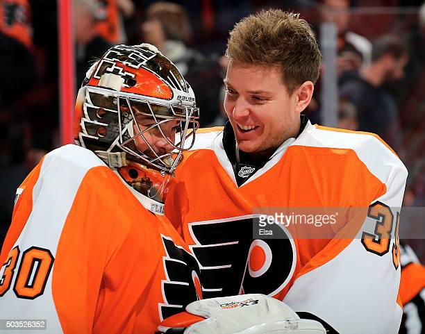 Michal Neuvirth of the Philadelphia Flyers is congratulated by teammate Steve Mason after the win over the Montreal Canadiens at the Wells Fargo...