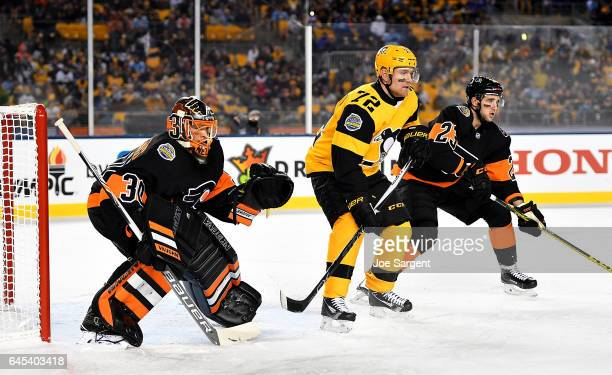 Michal Neuvirth of the Philadelphia Flyers protects the net against Patric Hornqvist of the Pittsburgh Penguins during the 2017 Coors Light NHL...