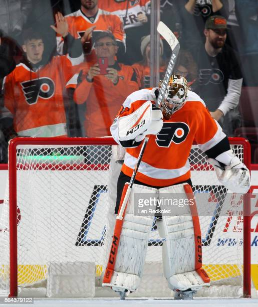 Michal Neuvirth of the Philadelphia Flyers reacts after defeating the Florida Panthers 51 on October 17 2017 at the Wells Fargo Center in...