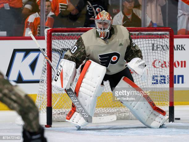 Michal Neuvirth of the Philadelphia Flyers wearing a camouflage jersey in honor of Military Appreciation night warms up against the Minnesota Wild on...