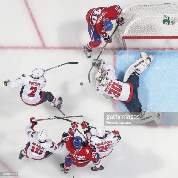 Michal Neuvirth of the Washington Capitals blocks a shot of Maxim Lapierre of Montreal Canadiens during the NHL game on February 10 2010 at the Bell...