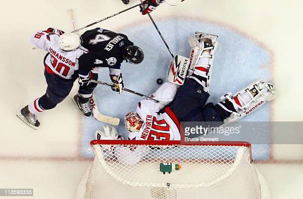 Michal Neuvirth of the Washington Capitals makes the save on Vincent Lecavalier of the Tampa Bay Lightning in Game Three of the Eastern Conference...