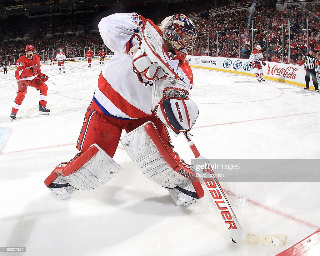 <a gi-track='captionPersonalityLinkClicked' href=/galleries/search?phrase=Michal+Neuvirth&family=editorial&specificpeople=3205600 ng-click='$event.stopPropagation()'>Michal Neuvirth</a> #30 of the Washington Capitals plays the puck behind the net as Drew Miller #20 of the Detroit Red Wings pressures him during an NHL game on January 31, 2014 at Joe Louis Arena in Detroit, Michigan. Detroit defeated Washington 4-3 in a shootout.