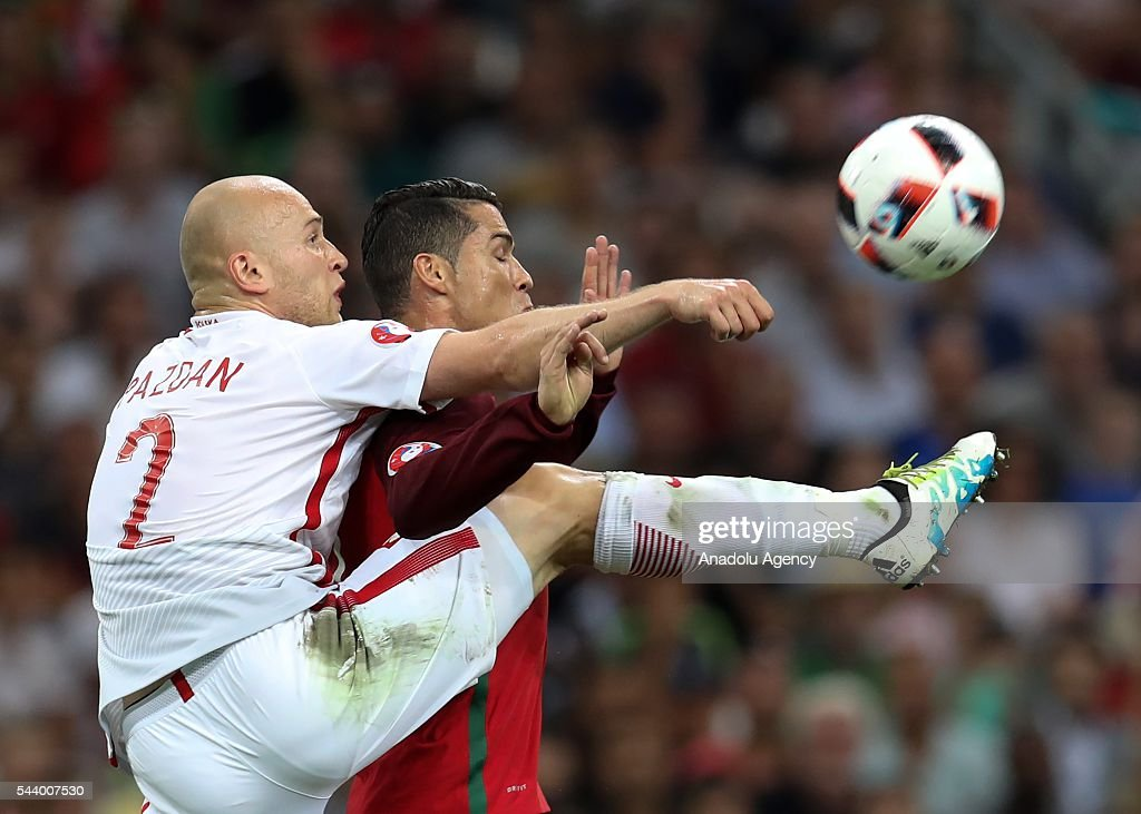 Michal Pazdan (L) of Poland in action against Cristiano Ronaldo (R) of Portugal during the Euro 2016 quarter-final football match between Poland and Portugal at the Stade Velodrome in Marseille, France on June 30, 2016.