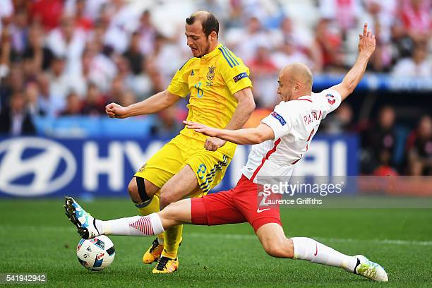 Michal Pazdan of Poland tackles Roman Zozulya of Ukraine during the UEFA EURO 2016 Group C match between Ukraine and Poland at Stade Velodrome on...