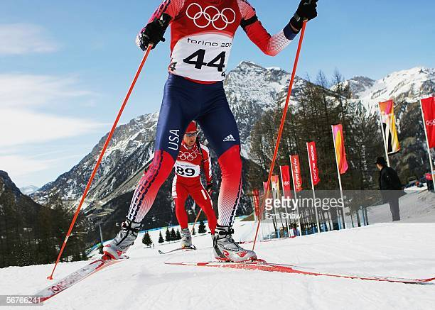 Michal Piecha of Poland is shown through the legs of Brian Olsen of the United States during practice on the Biathlon course prior to the Turin 2006...
