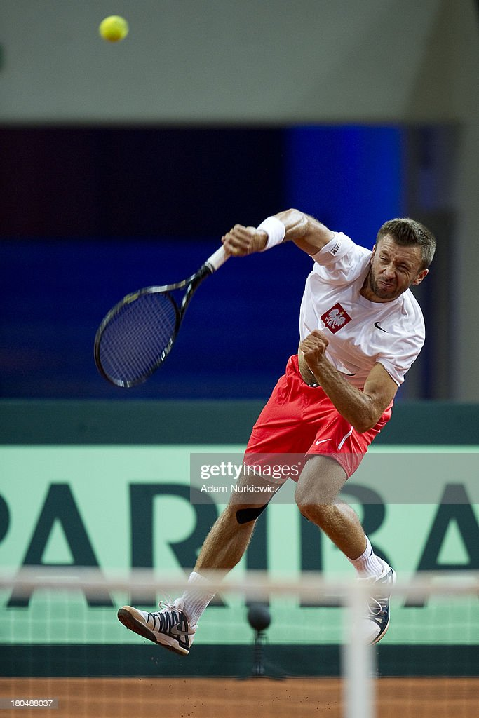 Michal Przysiezny of Poland in action during the Davis Cup match between Poland and Australia at the Torwar Hall, on September 13, 2013 in Warsaw, England.