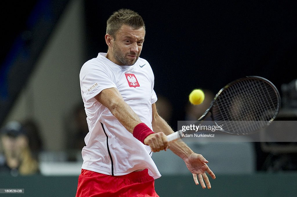 Michal Przysiezny of Poland in action during the Davis Cup match between Poland and Australia at the Torwar Hall on September 15, 2013 in Warsaw, Poland.