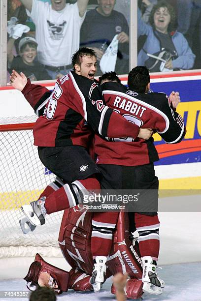Michal Repik and Wacey Rabbit rush Tyson Sexsmith of the Vancouver Giants after the final buzzer during the final game of the 2007 Mastercard...