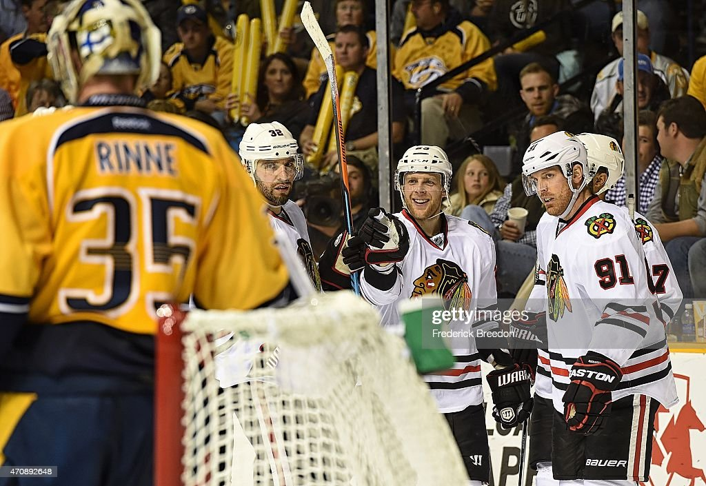 Michal Rozsival #32 and Brad Richards #91 congratulate teammate Kris Versteeg #23 on scoring a goal against goalie Pekka Rinne #35 of the Nashville Predators during the third period of Game Five of the Western Conference Quarterfinals during the 2015 NHL Stanley Cup Playoffs at Bridgestone Arena on April 23, 2015 in Nashville, Tennessee.