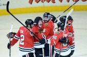 Michal Rozsival Andrew Shaw Nick Leddy Dave Bolland and Bryan Bickell of the Chicago Blackhawks celebrate after Shaw scored the gamewinning goal in...