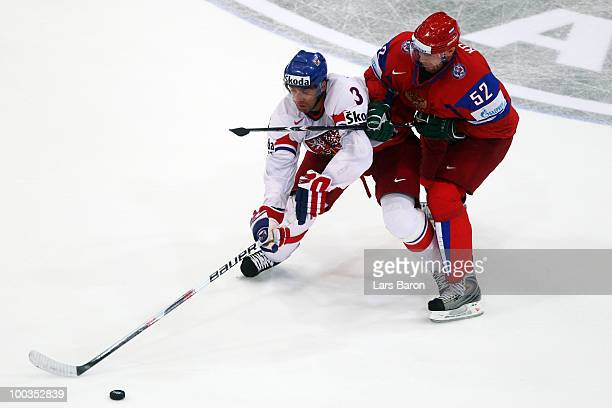 Michal Rozsival of Czech Republic is challenged by Viktor Kozlov of Russia during the IIHF World Championship gold medal match between Russia and...