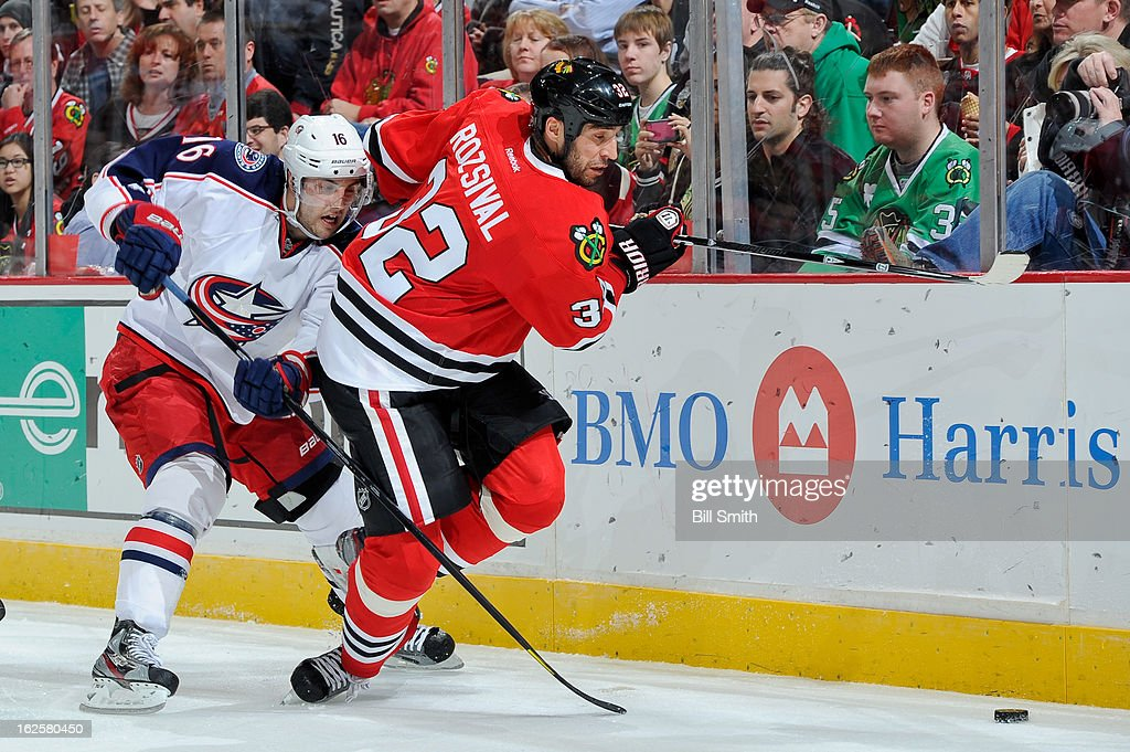 <a gi-track='captionPersonalityLinkClicked' href=/galleries/search?phrase=Michal+Rozsival&family=editorial&specificpeople=216462 ng-click='$event.stopPropagation()'>Michal Rozsival</a> #32 of the Chicago Blackhawks and <a gi-track='captionPersonalityLinkClicked' href=/galleries/search?phrase=Derick+Brassard&family=editorial&specificpeople=540468 ng-click='$event.stopPropagation()'>Derick Brassard</a> #16 of the Columbus Blue Jackets fight for the puck during the NHL game on February 24, 2013 at the United Center in Chicago, Illinois.