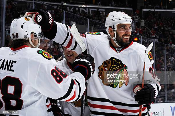 Michal Rozsival of the Chicago Blackhawks celebrates with his teammates after Brad Richards of the Chicago Blackhawks goal at STAPLES Center on...