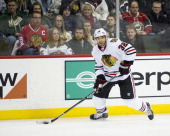 Michal Rozsival of the Chicago Blackhawks controls the puck during the game against the Minnesota Wild on January 23 2014 at Xcel Energy Center in St...