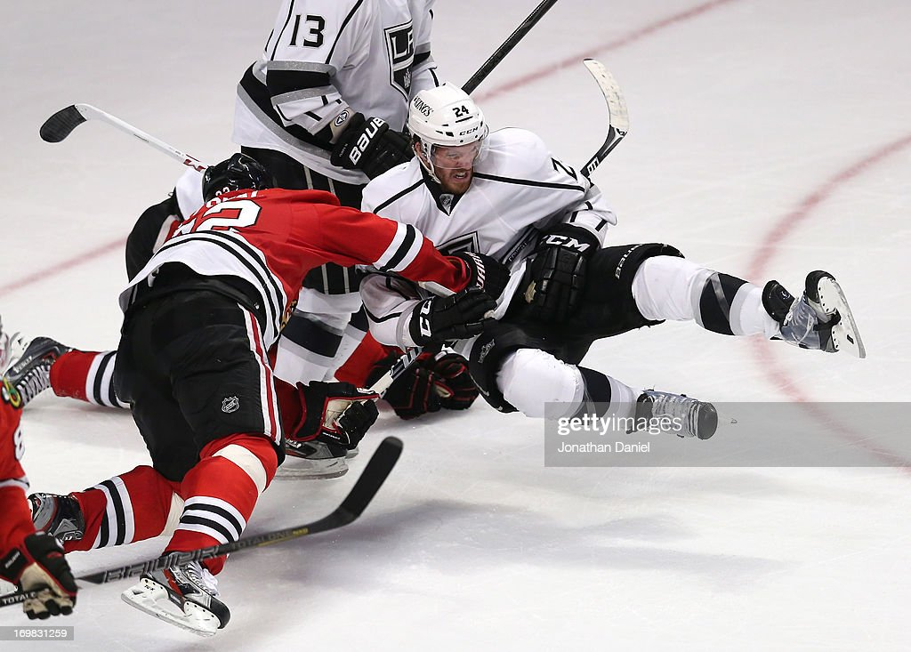 <a gi-track='captionPersonalityLinkClicked' href=/galleries/search?phrase=Michal+Rozsival&family=editorial&specificpeople=216462 ng-click='$event.stopPropagation()'>Michal Rozsival</a> #32 of the Chicago Blackhawks cross checks <a gi-track='captionPersonalityLinkClicked' href=/galleries/search?phrase=Colin+Fraser&family=editorial&specificpeople=2225768 ng-click='$event.stopPropagation()'>Colin Fraser</a> #24 of the Los Angeles Kings near the crease area in the low slot in the third period of Game Two of the Western Conference Final during the 2013 NHL Stanley Cup Playoffs at United Center on June 2, 2013 in Chicago, Illinois. The Blackhawks defeated the Kings 4-2.
