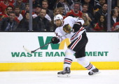 Michal Rozsival of the Chicago Blackhawks follows through on his shot from the point during the first period of the NHL game against the Los Angeles...