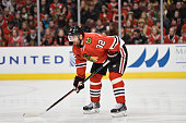 Michal Rozsival of the Chicago Blackhawks gets ready for a faceoff against the Toronto Maple Leafs during the first period at the United Center on...