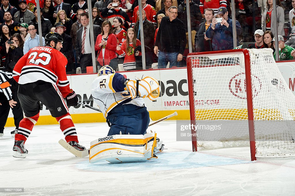<a gi-track='captionPersonalityLinkClicked' href=/galleries/search?phrase=Michal+Rozsival&family=editorial&specificpeople=216462 ng-click='$event.stopPropagation()'>Michal Rozsival</a> #32 of the Chicago Blackhawks gets the puck past goalie <a gi-track='captionPersonalityLinkClicked' href=/galleries/search?phrase=Pekka+Rinne&family=editorial&specificpeople=2118342 ng-click='$event.stopPropagation()'>Pekka Rinne</a> #35 of the Nashville Predators during the shoot-out to score the game-winning goal during the NHL game on April 01, 2013 at the United Center in Chicago, Illinois.