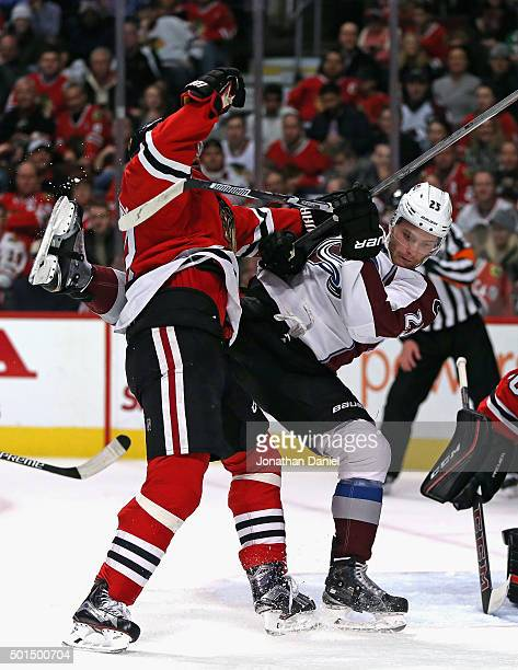 Michal Rozsival of the Chicago Blackhawks hits Mikhail Grigorenko of the Colorado Avalanche at the United Center on December 15 2015 in Chicago...