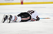 Michal Rozsival of the Chicago Blackhawks lays on the ice after an injury during the second period in Game Four of the Western Conference Semifinals...