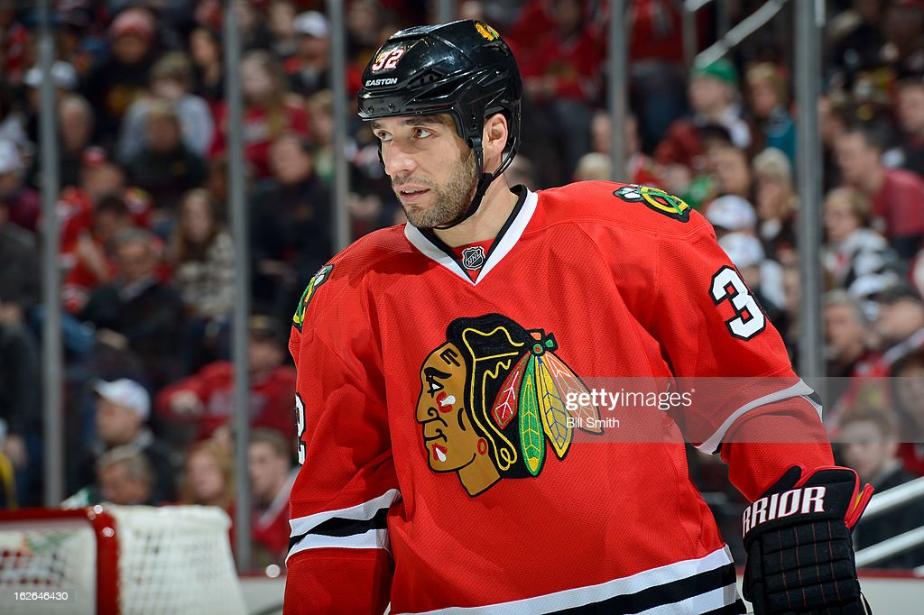 Michal Rozsival #32 of the Chicago Blackhawks looks down the ice during the NHL game against the San Jose Sharks on February 22, 2013 at the United Center in Chicago, Illinois.