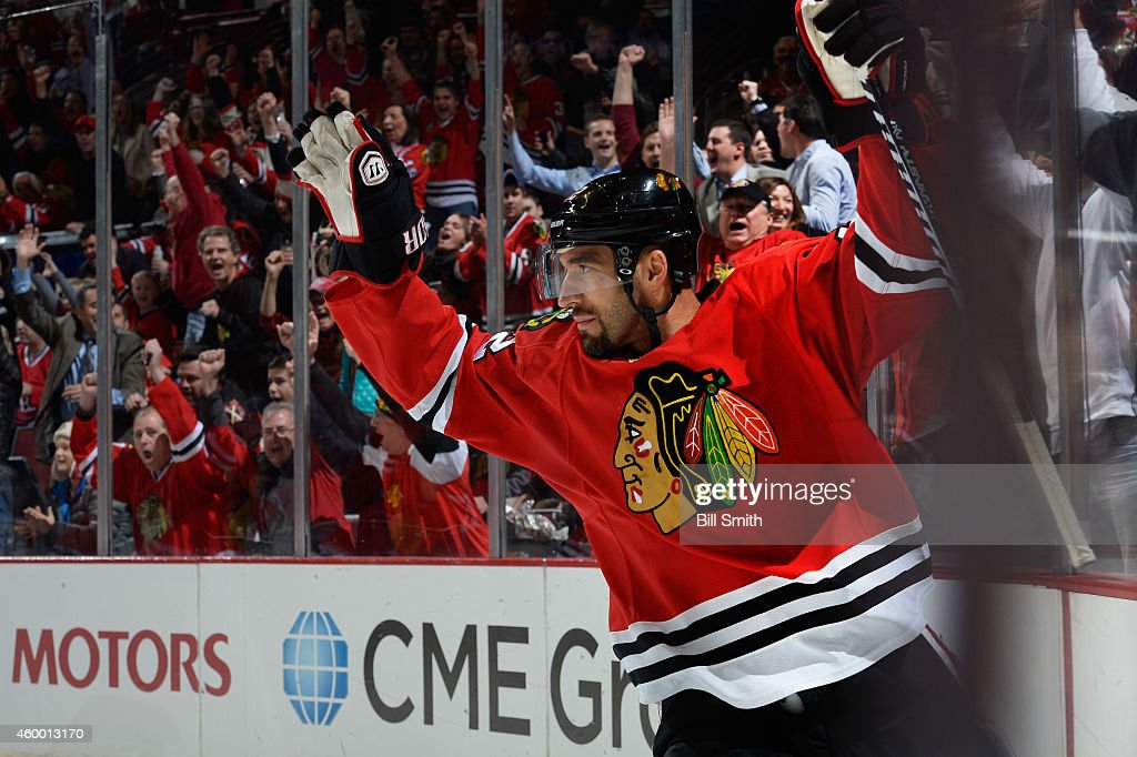 Michal Rozsival of the Chicago Blackhawks reacts after scoring against the Montreal Canadiens early in the first period during the NHL game at the...