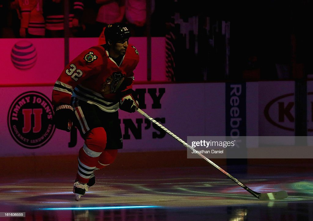 Michal Rozsival #32 of the Chicago Blackhawks skates onto the ice during player introductions before a game against the Anaheim Ducks at the United Center on February 12, 2013 in Chicago, Illinois. The Ducks defeated the Blackhawks 3-2 in a shootout.