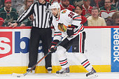 Michal Rozsival of the Chicago Blackhawks skates with the puck against the Minnesota Wild in Game Four of the Western Conference Semifinals during...