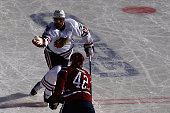 Michal Rozsival of the Chicago Blackhawks tries to control the puck during the first period of the 2015 NHL Winter Classic against the Washington...