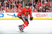 Michal Rozsival of the Chicago Blackhawks watches for the puck in Game Two of the Second Round of the 2014 Stanley Cup Playoffs against the Minnesota...