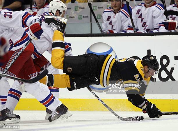 Michal Rozsival of the New York Rangers trips up David Krejci of the Boston Bruins at the TD Garden on October 23 2010 in Boston Massachusetts
