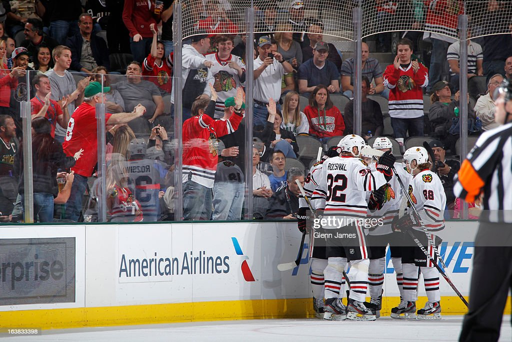 Michal Rozsival #32, Patrick Kane #88 and the Chicago Blackhawks celebrate a goal against the Dallas Stars at the American Airlines Center on March 16, 2013 in Dallas, Texas.