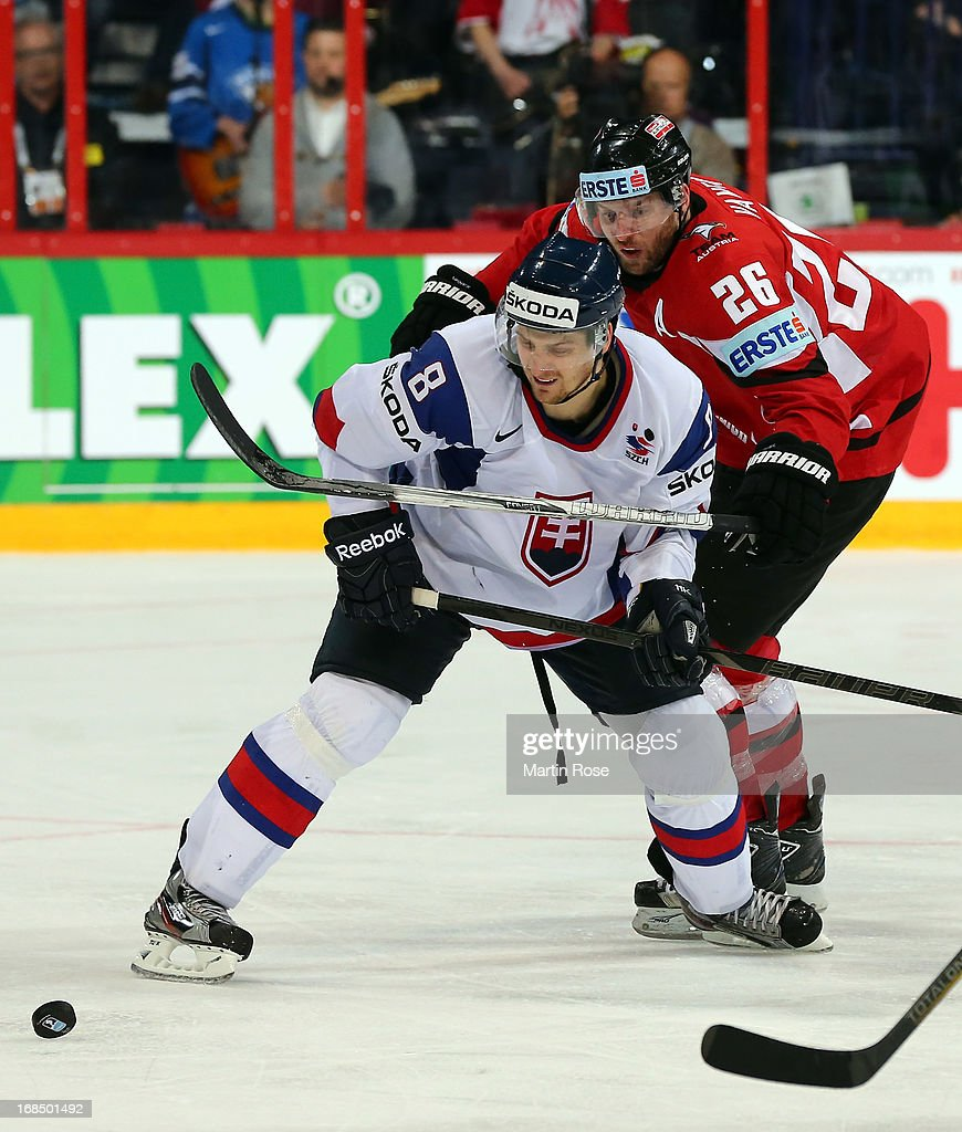 Michal Sersen (#8) of Slovakia and <a gi-track='captionPersonalityLinkClicked' href=/galleries/search?phrase=Thomas+Vanek&family=editorial&specificpeople=570606 ng-click='$event.stopPropagation()'>Thomas Vanek</a> (#26) of Austria battle for the puck during the IIHF World Championship group H match between Slovakia and Austria at Hartwall Areena on May 10, 2013 in Helsinki, Finland.